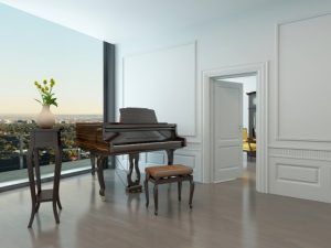 grand piano in a beautiful white room with large window